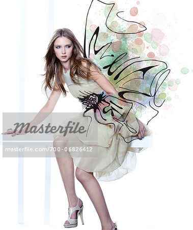 Young Woman Fashion Model Wearing Dress with Embellishment Illustration of Bow Stock Photo - Rights-Managed, Image code: 700-06826412