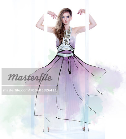 Young Woman Fashion Model Wearing Dress with Illustrated Embellishments Stock Photo - Rights-Managed, Image code: 700-06826413