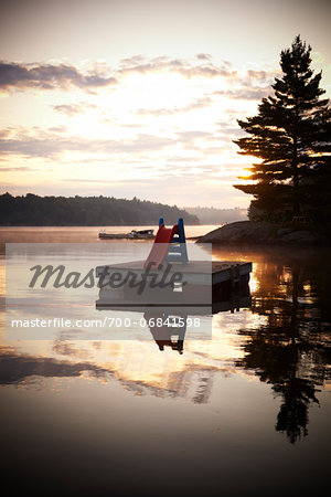 Slide on Floating Dock in Morning, Riley Lake, Muskoka, Northern Ontario, Canada. Stock Photo - Rights-Managed, Image code: 700-06841598