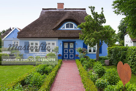 Traditional house with thatched roof and garden in Born, Fischland-Darss-Zingst, Coast of the Baltic Sea, Mecklenburg-Western Pomerania, Germany, Europe Stock Photo - Rights-Managed, Image code: 700-06892498