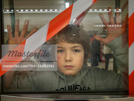 young boy behind blocked door in parisian subway, Paris, France Stock Photo - Rights-Managed, Image code: 700-06892582