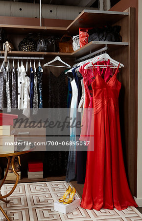 Close up of women's closet fully stocked with clothes, shoes and accessories Stock Photo - Rights-Managed, Image code: 700-06895097