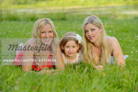 Cloase-up of Woman with her daughter and her mother in summer, Bavaria, Germany. Stock Photo - Rights-Managed, Image code: 700-06939634