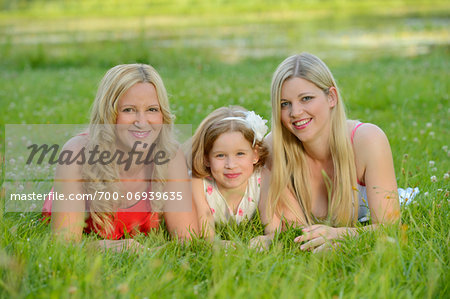 Close-up of a woman with her daughter and her mother in summer, Bavaria, Germany. Stock Photo - Rights-Managed, Image code: 700-06939635