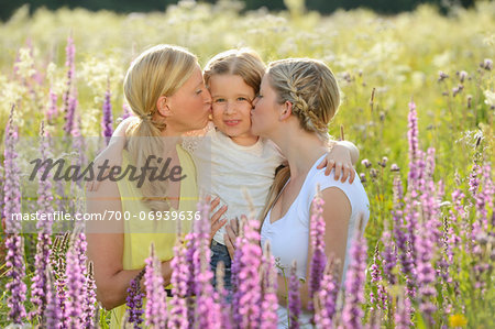Close-up of a woman with her daughter and her mother in a flower meadow in summer, Bavaria, Germany. Stock Photo - Rights-Managed, Image code: 700-06939636