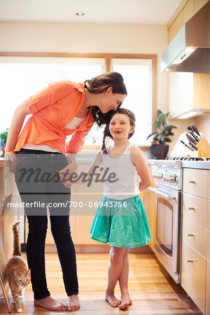Mother and daughter in a kitchen. Stock Photo - Rights-Managed, Image code: 700-06943756