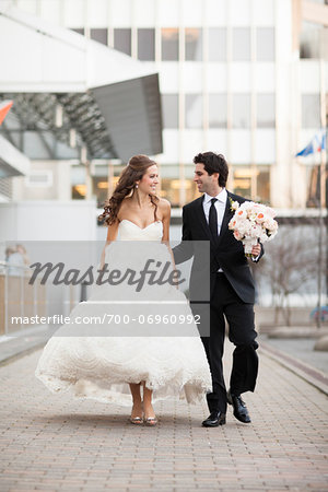Bride and Groom walking towards camera along walkway in City Park on Wedding Day, Toronto, Ontario, Canada Stock Photo - Rights-Managed, Image code: 700-06960992
