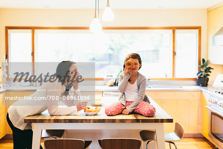 Mom and daughter in a modern kitchen, Oregon, USA Stock Photo - Rights-Managed, Image code: 700-06961896
