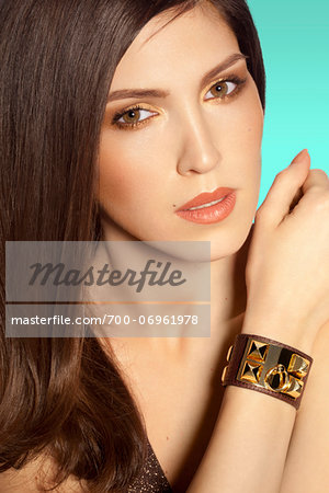 Close-up Portrait of Woman wearing bracelet, studio shot Stock Photo - Rights-Managed, Image code: 700-06961978