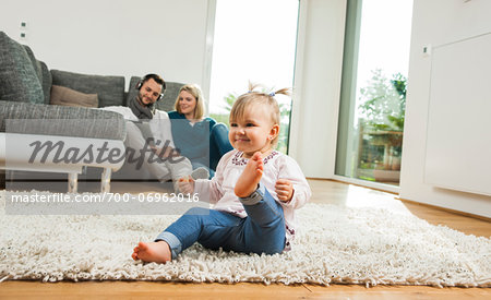 Family Relaxing in Living Room, Mannheim, Baden-Wurttemberg, Germany Stock Photo - Rights-Managed, Image code: 700-06962016
