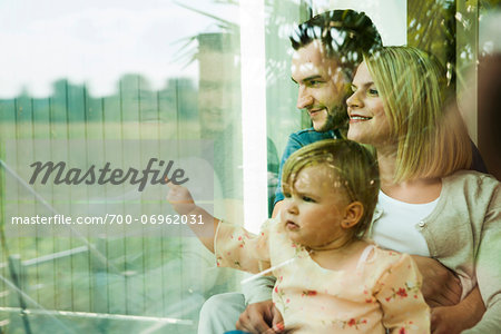Family Looking out Window at Home, Mannheim, Baden-Wurttemberg, Germany Stock Photo - Rights-Managed, Image code: 700-06962031