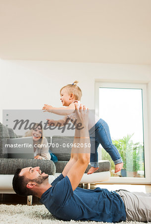 Family in Living Room at Home, Mannheim, Baden-Wurttemberg, Germany Stock Photo - Rights-Managed, Image code: 700-06962050