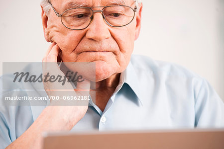 Senior Man using Laptop at Home, Mannheim, Baden-Wurttemberg, Germany Stock Photo - Rights-Managed, Image code: 700-06962181