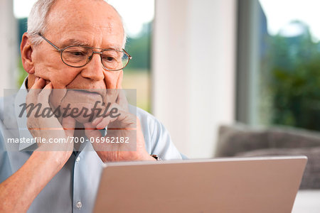 Senior Man using Laptop at Home, Mannheim, Baden-Wurttemberg, Germany Stock Photo - Rights-Managed, Image code: 700-06962182