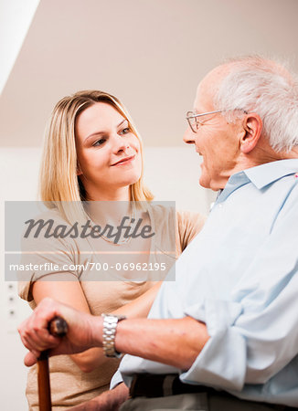 Young Woman and Senior Man Talking, Mannheim, Baden-Wurttemberg, Germany Stock Photo - Rights-Managed, Image code: 700-06962195