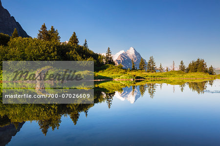 Reflection of Eiger Peak in an Alpine Lake at Sunrise, Bernese Alps, Grosse Scheidegg, Canton of Bern, Switzerland Stock Photo - Rights-Managed, Image code: 700-07026609