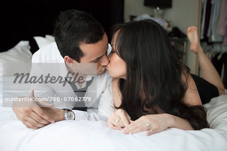 Close-up of couple in bed, kissing Stock Photo - Rights-Managed, Image code: 700-07062778