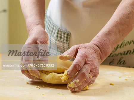 Close-up of elderly Italian woman's hands kneading pasta dough in kitchen, Ontario, Canada Stock Photo - Rights-Managed, Image code: 700-07108332