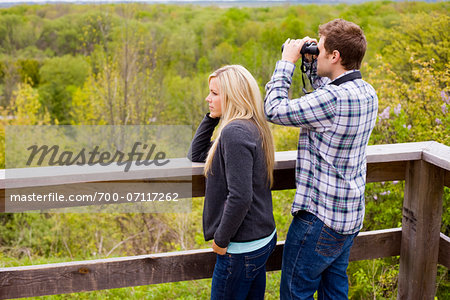 Young Couple using Binoculars on Lookout, Scanlon Creek Conservation Area, Bradford, Ontario, Canada Stock Photo - Rights-Managed, Image code: 700-07117262