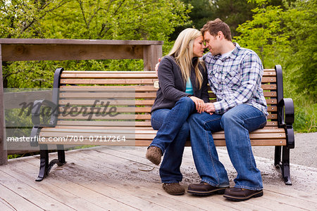 Young Couple on Park Bench, Scanlon Creek Conservation Area, Bradford, Ontario, Canada Stock Photo - Rights-Managed, Image code: 700-07117264