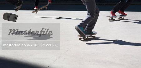 Close-up of multiple skateboarders practicing moves, downtown Toronto, Ontario, Canada Stock Photo - Rights-Managed, Image code: 700-07122852