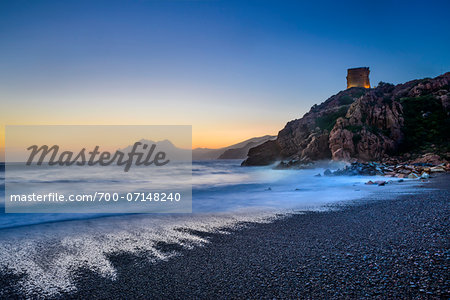 Scenic view of beach, surf and Genoese Watchtower at sunset, Gulf of Porto, Corsica, France Stock Photo - Rights-Managed, Image code: 700-07148240
