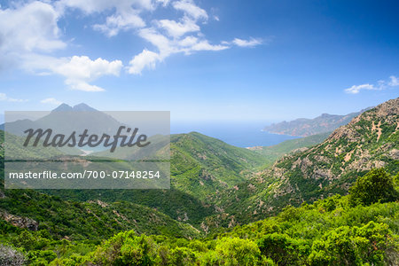 Scenic view of mountains, Girolata Gulf, in the background on the right Scandola Nature Reserve (a Unesco World Heritage Site) between Calvi, Porto and Galeria, Corsica, France Stock Photo - Rights-Managed, Image code: 700-07148254