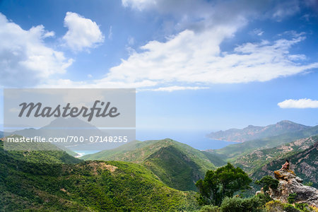 Scenic view of mountains, Girolata Gulf, in the background on the right Scandola Nature Reserve (a Unesco World Heritage Site) between Calvi, Porto and Galeria, Corsica, France Stock Photo - Rights-Managed, Image code: 700-07148255