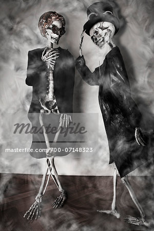 Elegant Skeleton Greets a Charmed Lady Skeleton Stock Photo - Rights-Managed, Image code: 700-07148323