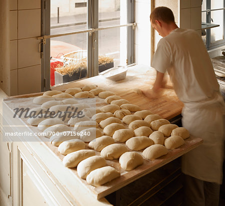 Male baker shaping baguette bread dough by hand in bakery, Le Boulanger des Invalides, Paris, France Stock Photo - Rights-Managed, Image code: 700-07156240