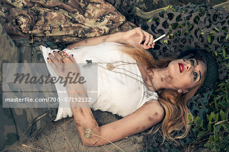 Woman Soldier with Cigarette Stock Photo - Rights-Managed, Image code: 700-07192132