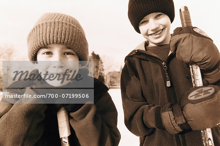 Portrait of Two Boys with Hockey Sticks Outdoors Stock Photo - Rights-Managed, Image code: 700-07199506
