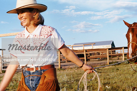 Woman Pulling Horse Stock Photo - Rights-Managed, Image code: 700-07199570
