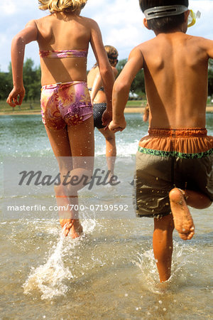 Children Running Through Water At Beach Stock Photo - Rights-Managed, Image code: 700-07199592