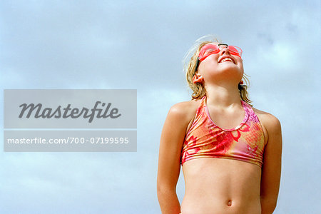 Girl in Bathing Suit Looking Up At Sky Stock Photo - Rights-Managed, Image code: 700-07199595