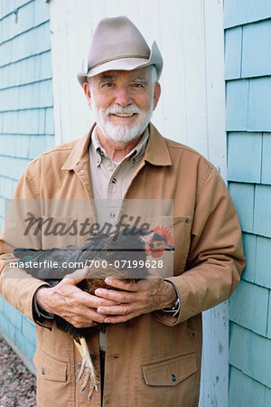 Portrait of Man Holding Chicken Stock Photo - Rights-Managed, Image code: 700-07199628