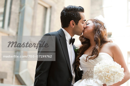 Portrait of Bride and Groom Kissing Outdoors Stock Photo - Rights-Managed, Image code: 700-07199762