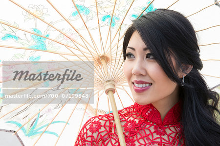 Close-up portrait of young woman holding Chinese parasol, Ontario, Canada Stock Photo - Rights-Managed, Image code: 700-07199848