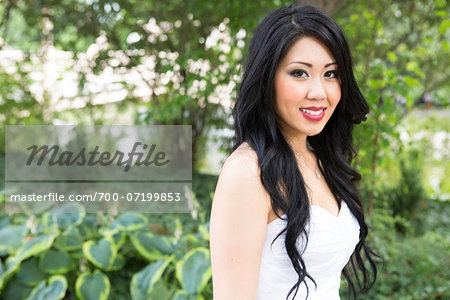 Close-up portrait of bride, standing in public garden, smiling and looking at camera, Ontario, Canada Stock Photo - Rights-Managed, Image code: 700-07199853