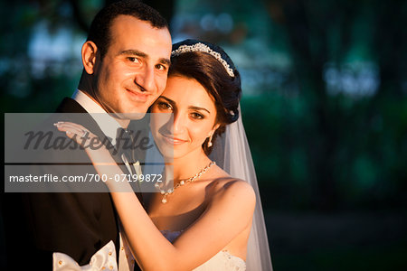 Close-up portrait of bride and groom embracing, smiling and looking at camera, Ontario, Canada Stock Photo - Rights-Managed, Image code: 700-07199872