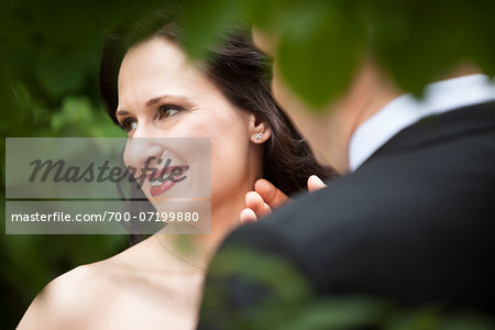 Close-up portrait of bride and groom, standing outdoors, Ontario, Canada Stock Photo - Rights-Managed, Image code: 700-07199880