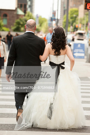 Backview of bride and groom walking across intersection of city street, Toronto, Ontario, Canada Stock Photo - Rights-Managed, Image code: 700-07199882