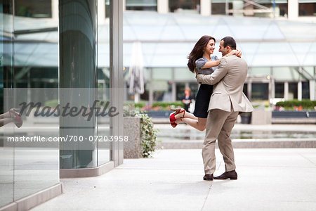Excited couple embracing on ciity street sidewalk, Toronto, Ontario, Canada Stock Photo - Rights-Managed, Image code: 700-07203958
