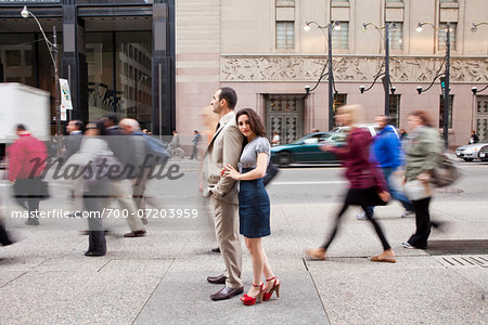 Couple standing on sidewalk on busy, city street, Toronto, Ontario, Canada Stock Photo - Rights-Managed, Image code: 700-07203959