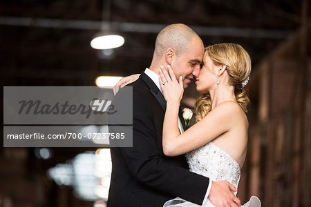 Bride and groom embracing at wedding venue on Wedding Day, Canada Stock Photo - Rights-Managed, Image code: 700-07237585