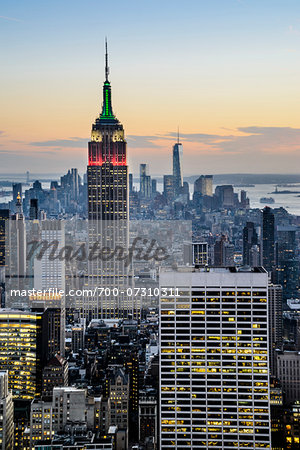 South Manhattan view of skyline from Top of the Rock Observation Deck, Rockefeller Center at dusk, with Empire State Building illuminated with colours of the Italian flag, Columbus Day, Midtown, Manhattan, New York City, New York, USA Stock Photo - Rights-Managed, Image code: 700-07310311
