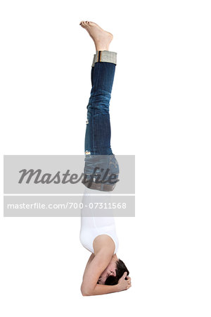 Woman in headstand yoga position in the forearm balance pose, studio shot on white background Stock Photo - Rights-Managed, Image code: 700-07311568