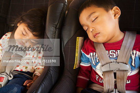 Close-up of toddler siblings napping in their child safety car seats, USA Stock Photo - Rights-Managed, Image code: 700-07311590
