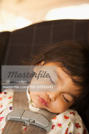 Close-up of toddler girl sleeping in child safety seat, USA Stock Photo - Rights-Managed, Image code: 700-07311591