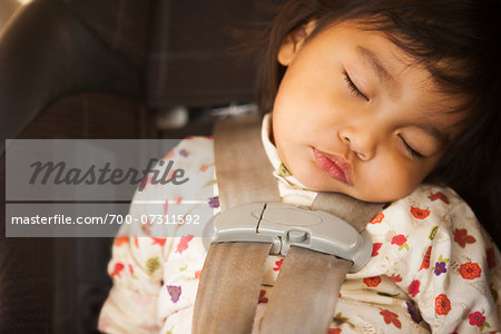 Close-up of toddler girl sleeping in child safety seat, USA Stock Photo - Rights-Managed, Image code: 700-07311592